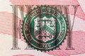 Stamp of the Department of The Treasury on US fifty dollar bill closeup macro Royalty Free Stock Photo