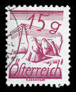 Stamp printed in Austria, is depicted Fields Crossed by Telegraph Wires Royalty Free Stock Photo