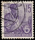 Stamp printed in GDR, shows worker Royalty Free Stock Photo