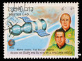 Stamp printed in Laos shows Soyuz 19 and crew A. Leonov and V. Kubasov Royalty Free Stock Photo