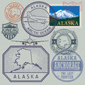 Stamp set with the name and map of Alaska Royalty Free Stock Photo