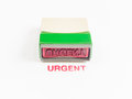 Stamp with urgent in red ink on white background Royalty Free Stock Image