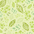 Stamped green leaves seamless pattern background vector with abstract plants with fun and branches forming a floral texture Royalty Free Stock Photo