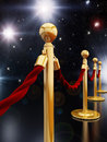 Stanchion posts gold and velvet ropes Stock Photos