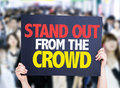 Stand out from the crowd card with crowd of people on background Stock Image
