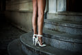Stand on stairs woman legs in elegant white high heel shoes outdoor shot Royalty Free Stock Photo