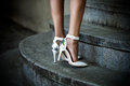 Stand on stairs woman legs in elegant white high heel shoes outdoor shot Royalty Free Stock Images