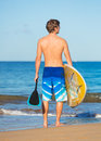 Stand up paddle board man with sup on the beach in hawaii Stock Images