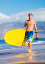 Stand up paddle board man with sup on the beach in hawaii Royalty Free Stock Images