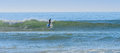 Stand up paddle surfer at a surf break in morocco near the fishing village of taghazoute Royalty Free Stock Image