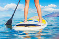 Stand up paddle surfing in hawaii attractive young woman beautiful tropical ocean active beach lifestyle Stock Photo