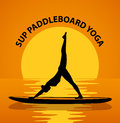 Stand up paddleboard Yoga. Woman silhouette in downwards facing dog leg air pose