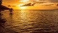Stand up paddler SUP on Sunset, Kri Island. Raja Ampat, Indonesia, West Papua Royalty Free Stock Photo