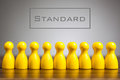 Standard concept with pawn figurines on table Royalty Free Stock Photo