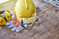 Standard construction safety equipment on wooden table. top view Royalty Free Stock Photo