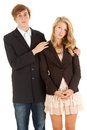 Standing ashamed teenage couple Stock Photo
