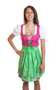 Standing bavarian woman with brown hair ready for dirndl and the oktoberfest on an isolated white background cut out Royalty Free Stock Photography