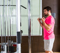 Standing biceps cable curl man in pulley machine Royalty Free Stock Photo