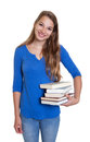 Standing blond student with books on an isolated white background for cut out Royalty Free Stock Photo