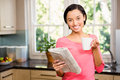 Standing brunette holding cup and newspaper Royalty Free Stock Photo