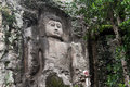 Standing buddha rock cut in dhowa temple near bandatrawela sri lanka Stock Photos