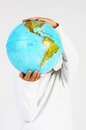 Standing child boy holding a globe in hands in front of his head on white background Royalty Free Stock Photos