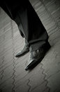 Standing imposing man in a patent leather shoes. legs only Stock Photography
