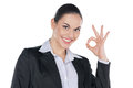 Standing isolated on white portrait of smiling businesswoman with ok gesture Stock Photos