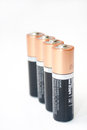 Standing lined alkaline aa batteries Royalty Free Stock Photography