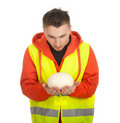 Standing manual worker holding Ostriches Egg Stock Photos