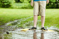 Standing in puddle with flippers unidentifiable person shorts and scuba middle of large on turf grass Royalty Free Stock Photo