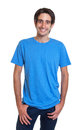 Standing spanish guy in a blue shirt with short black hair laughing at camera on an isolated white background Stock Photo
