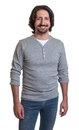 Standing turkish guy with long black hair and beard pointing at camera on an isolated white background for cut out Royalty Free Stock Images