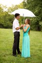 Standing under a umbrella Stock Images