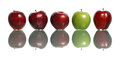Standout apple a green being among red apples isolated on white background Stock Photography