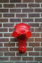 Standpipe a red on a brick wall Stock Image