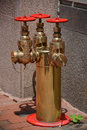 Standpipe shiny brass outside a building in washington dc Stock Photos