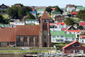 Stanley, Falkland Islands, Christ Church Cathedral and houses with colorful roofs Royalty Free Stock Photo