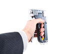 Staple gun in hand on a white background Royalty Free Stock Photography