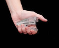 Stapler in female hand on a black background Royalty Free Stock Image