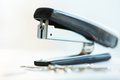 Stapler macro of a black office with metal paperclips in defocus Royalty Free Stock Image