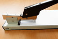 Stapler in progress stapling paper on the table Stock Photography