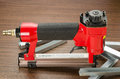 Stapler red pneumatic hand tool Royalty Free Stock Photo