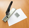Stapler and staples with paper Royalty Free Stock Photo