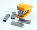 Stapler with staples small yellow spare Stock Images