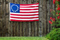Star american flag the betsy ross flag displayed on rustic wooden fence Stock Photography
