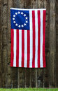 Star american flag the betsy ross flag displayed on rustic wooden fence Royalty Free Stock Photos