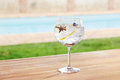 Star anise and cardamom gin and tonic cocktail on poolside bar Stock Image