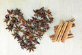 Star anise and cinnamon hear from on wooden background Royalty Free Stock Photo