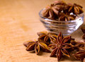 Star Anise in the Glass Bowl on Wooden Table Stock Photography